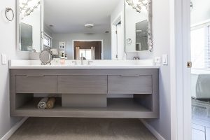 Wall to wall bathroom vanity installed by plumber in hamilton
