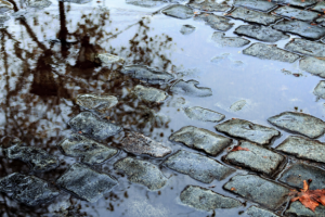 Close up of a puddle due to poor drainage