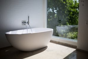 soaking tub beside the garden window