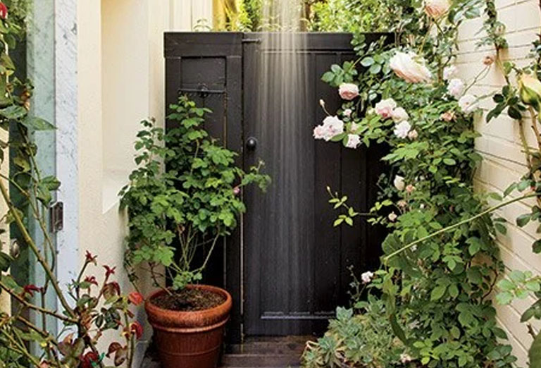 Shower beside roses in this Los Angeles home