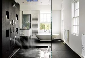 Concrete wetroom in Nantucket home with water jets