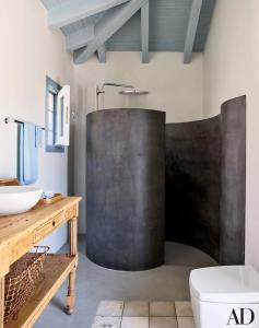 Spiral shower enclosure in a Greek home