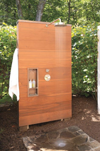 Outdoor shower with a cedar wall and recessed shelves
