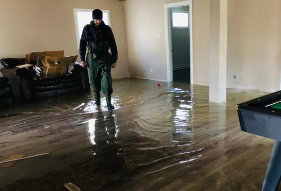 walking through a flooded house