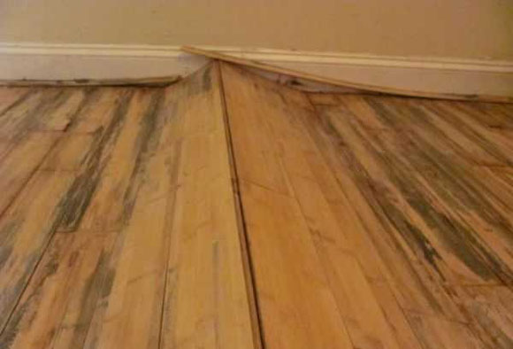 Close up of water-damaged wooden flooring