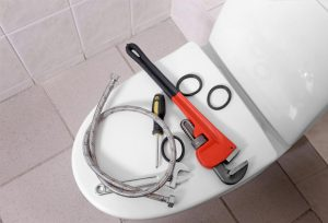 Tools on top of a toilet seat