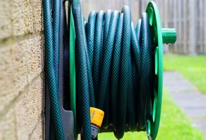 A hose bib with the hose attached to it