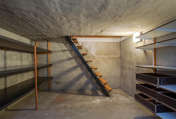 An unfinished basement that is dry and free of flood