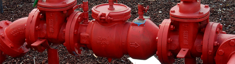 Close up of a reduced pressure zone device backflow preventer