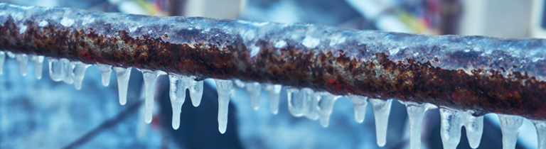 Close up of an exposed frozen pipe