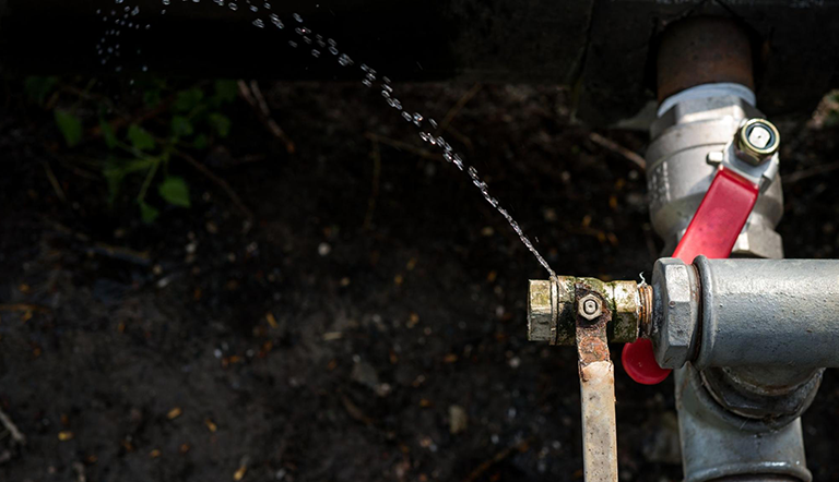 An outdoor tap with water leaking